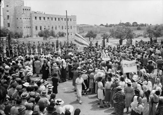 Jewish anti-Palestine white paper demonstrations - womens demonstration on may 22 1939- demonstration approaching king david hotel stopped by cordon of police seen in distance